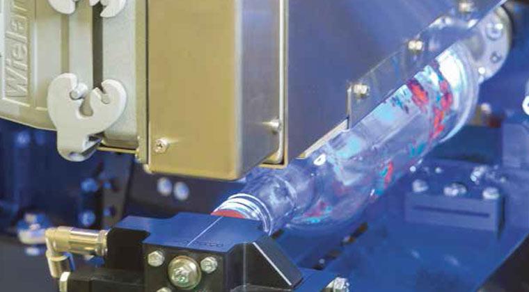 Machines pour la décoration industrielle de bouteilles et récipients en verre